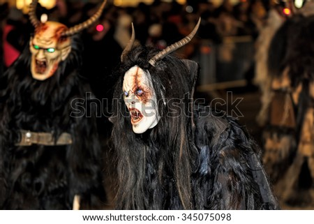 GRAZ, AUSTRIA-NOVEMBER 29: Unidentified person wearing an evil mask at Krampuslauf on Novemvber 29, 2015 in Graz. Krampuslauf is a traditional parade with pre-Christian roots.  - stock photo