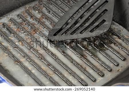 Greasy Cast Iron Pan Close up        - stock photo