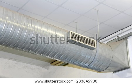 great air conditioning and heating with stainless steel tubing in a workshop - stock photo