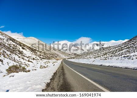 Great Alpine highway in winter. Arthurs Pass. New Zealand - stock photo