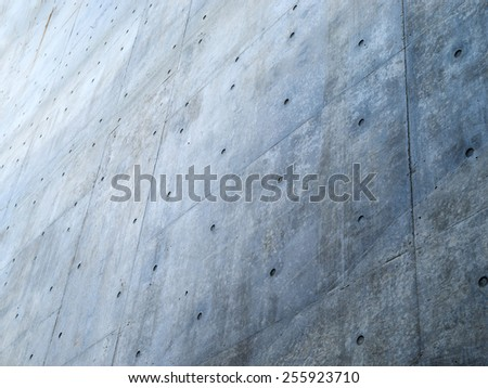 Great big concrete wall. Focus on forehand wall.   - stock photo
