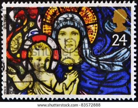 GREAT BRITAIN - CIRCA 1992: A stamp printed in Great Britain shows a stained glass window of the Virgin Mary and baby Jesus, circa 1992 - stock photo