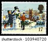 GREAT BRITAIN - CIRCA 1990: A stamp printed in Great Britain shows Children in play and snowman, Christmas scene, circa 1990. - stock photo