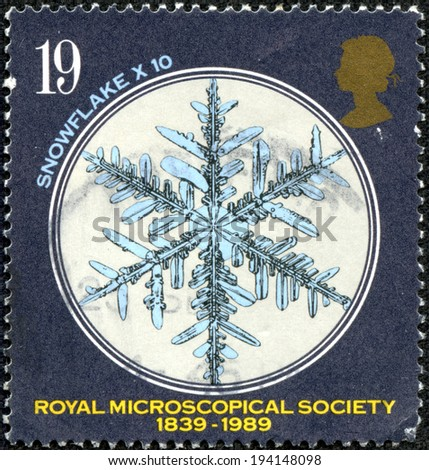 GREAT BRITAIN - CIRCA 1989: a stamp printed in the Great Britain shows Snowflake under Microscope, 150th anniversary of Royal Microscopical Society, circa 1989 - stock photo