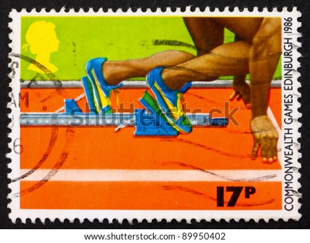 GREAT BRITAIN - CIRCA 1986: a stamp printed in the Great Britain shows Sprinter in the Starting Block, circa 1986 - stock photo