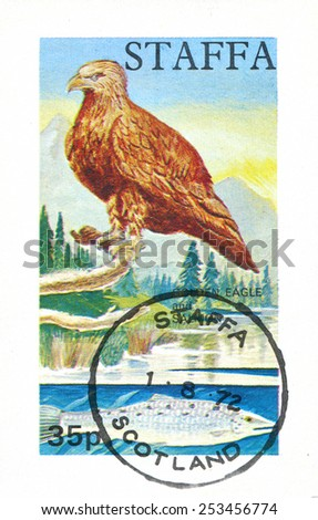 GREAT BRITAIN - CIRCA 1972: stamp printed by Great Britain, shows eagle and fish, circa 1972 - stock photo