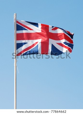 Great  Britain flag against blue sky - stock photo