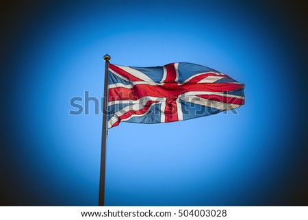 Great Britain Union Jack flag flying against blue sky