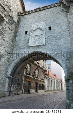 Great Coastal Gate, 16th century, and city coat of arms over the gate in old Tallinn, Estonia. - stock photo