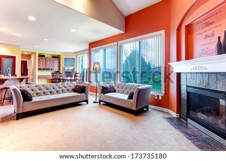 Great color combination. Orange walls make  your living room stand out - stock photo