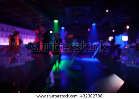 great colorful crowd shot in a nightclub. - stock photo