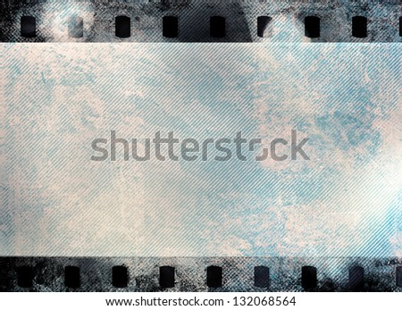 Great colour dark film strip for textures and backgrounds with light leak - stock photo
