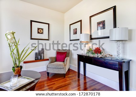 Great combination of light tone walls, whiskey hardwood floor and black storage table. Living room design - stock photo