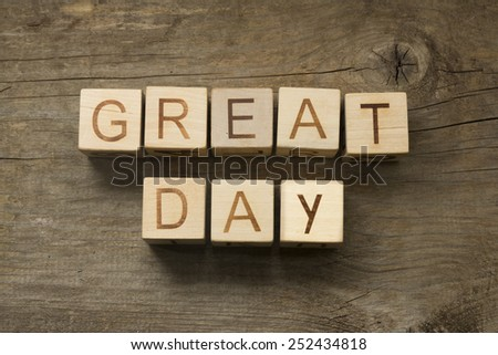 Great day text on a wooden background - stock photo