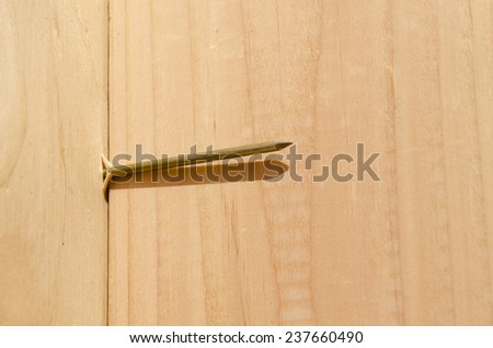 great example of a nailing blowout due to angle of nail gun on subsiding to stud on a wood wall - stock photo