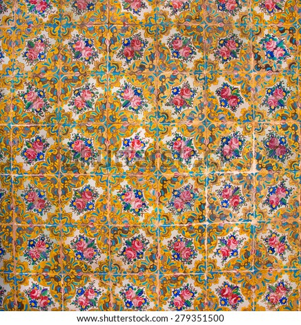 Great example of Islamic culture - historical tiles on the old house walls with patterns and flowers, Iran - stock photo