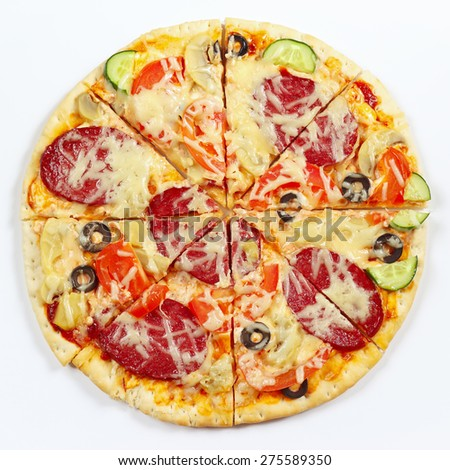 Great flavorful pizza sliced into chunks on a white background