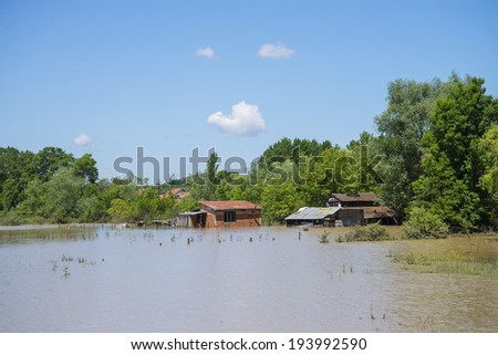 Great flood which included houses, fields, forests and roads - stock photo