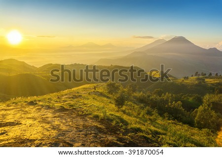 great golden sunrise in prau mount at central java indonesia - stock photo