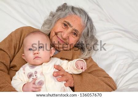 Great Grandma holding her great granddaughter - stock photo