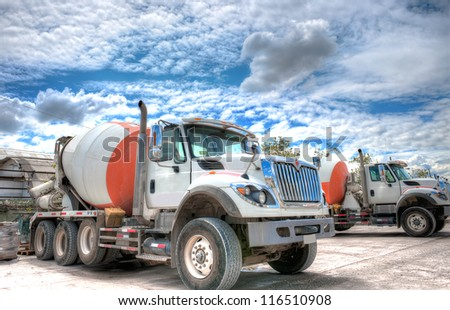 Great HDR shot of a mixer truck parked in a concrete company - stock photo