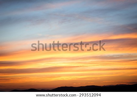 Great horizontal clouds at sunset - stock photo