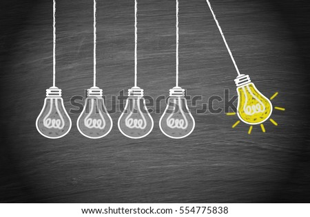 Great Idea and Creativity Concept with light bulbs on chalkboard background