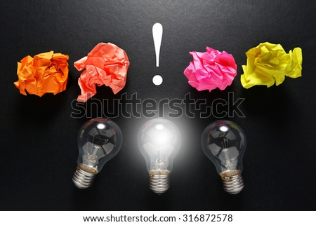 great idea concept with crumpled colorful paper and light bulb on grey background - stock photo