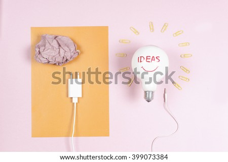 great idea concept with crumpled colorful paper and light bulb on light background. Creative brainstorm concept business idea, innovation and solution, creative design. - stock photo