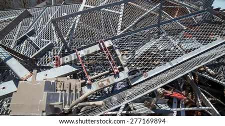 great Iron grid and ferrous material in the landfill of metallic objects - stock photo