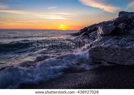 Great Lakes Summer Sunrise. Sunrise horizon along the Lake Huron coast. Lexington, Michigan. - stock photo