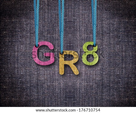 Great Letters hanging strings with blue sackcloth background. - stock photo