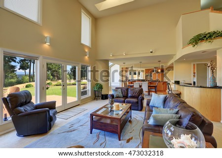 Great living room interior with high vaulted ceiling. Glass doors lead to the walkout deck. Northwest, USA
