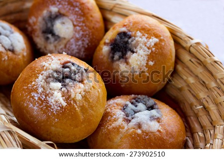 Great looking patisseries on wooden basket. Image from our stall at farmers market. Focus on center of foreground bun - stock photo