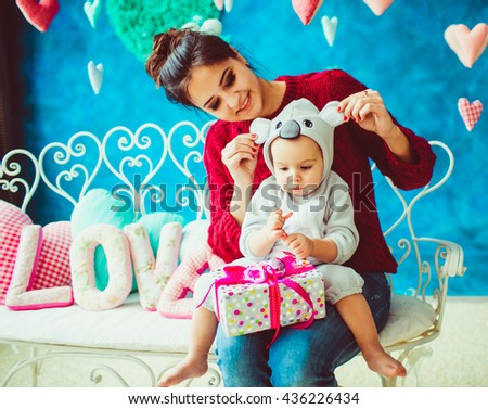 great mother holds her little  son - stock photo