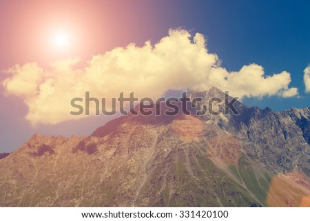 Great mountain peak with clouds