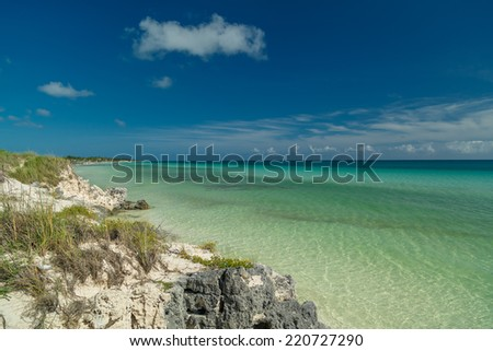 great natural,  wide open view of tranquil azure ocean against dramatic blue sky background, on summer gorgeous warm day - stock photo