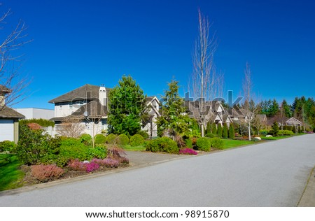 Great neighborhood. A homes  in suburbs at fall ( spring ) time in the north America. - stock photo