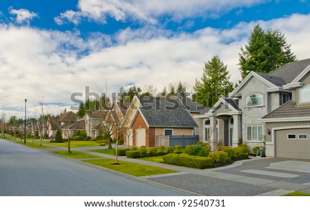 Great neighborhood. Homes in the suburbs of the North America. Canada. - stock photo