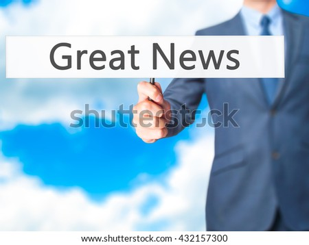 Great News - Businessman hand holding sign. Business, technology, internet concept. Stock Photo - stock photo