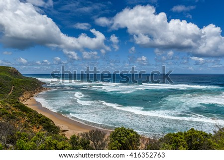 Great Ocean Road attraction in Victoria, Australia. Untouched seascapes. White Water beach. White cloudy sky.  Tour you never forget.