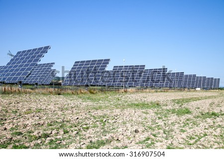 Great Park - alternative sources of producing electricity - PV meadow against the blue sky - stock photo