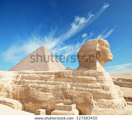 Great Pyramid of Pharaoh Khufu, located at Giza and the Sphinx. Egypt. - stock photo