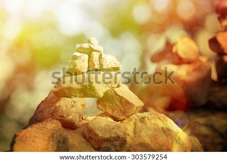 Great pyramid of stones on the background, of wild nature at sunset. zen - stock photo