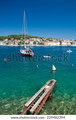 Great sea and boat in Mali Losinj - Croatia Vertical - stock photo