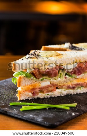 Great smoked salmon sandwich in a pub, ready to eat. - stock photo