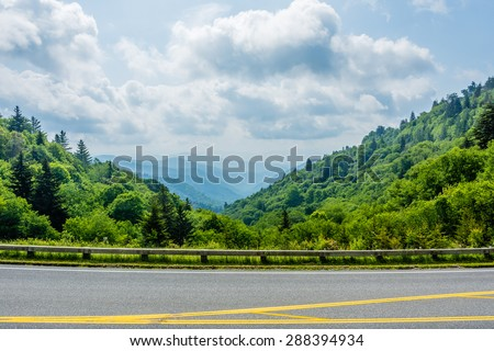 Great Smoky Mountains National Park, characteristic blue haze and mist rising from the Blue Ridge Mountains.  Overlook from parking lot. - stock photo
