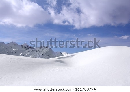 Great snow dunes and clouds in the background in Vogel, Slovenia - stock photo