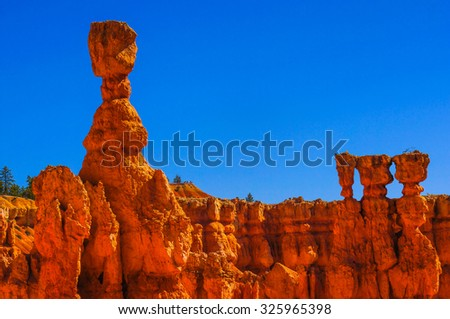 Great spires carved away by erosion in Bryce Canyon National Park, Utah, USA. The largest spire is called Thor's Hammer - stock photo