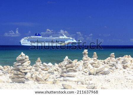 GREAT STIRRUP CAY, BAHAMAS - MARCH 24, 2012: NCL ship Norwegian Sky behind the beach at Great Stirrup Cay, Bahamas on March 24, 2012. - stock photo